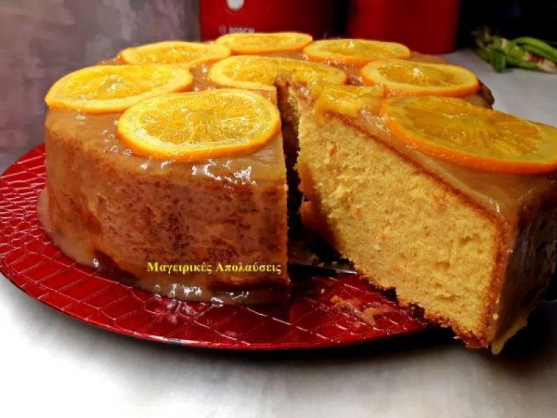 Κέικ με σάλτσα πορτοκαλιού και καραμελωμένες φέτες πορτοκάλι